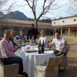 Cape scenic tours guests drinking wine