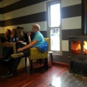 Winelands tour guests at fireplace