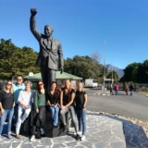 Cape peninsula tour guests at statue