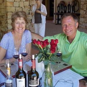 Guests eating at wine farm